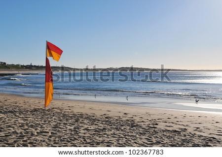 Surf flag on beach - stock photo