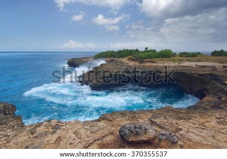 Surf on the rocks near the island of Lembongan Bali, Indonesia - stock photo