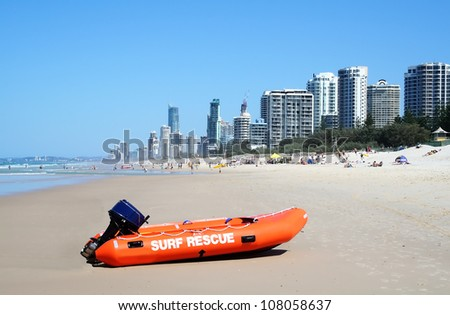 Surf rescue boat against the Surfers Paradise skyline on the Gold Coast Australia. - stock photo