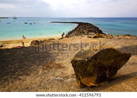 surf yacht pier  water  boat coastline and summer in lanzarote spain - stock photo
