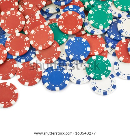 Surface covered with casino playing chips as a gambling background composition - stock photo