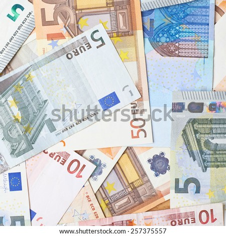 Surface covered with multilpe euro bank note bills as a background composition - stock photo