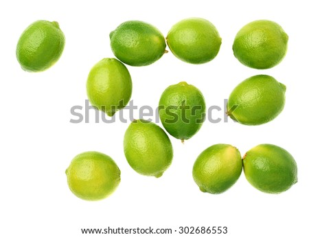Surface covered with multiple ripe limes, composition isolated over the white background, top view - stock photo