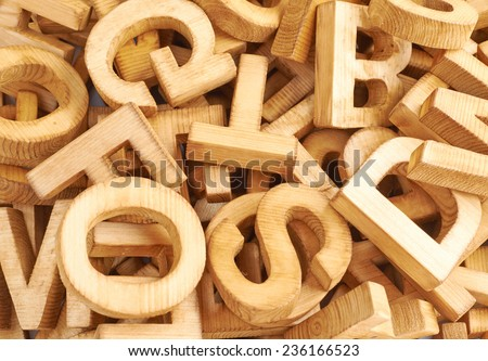 Surface covered with multiple wooden letters as a typography background composition - stock photo