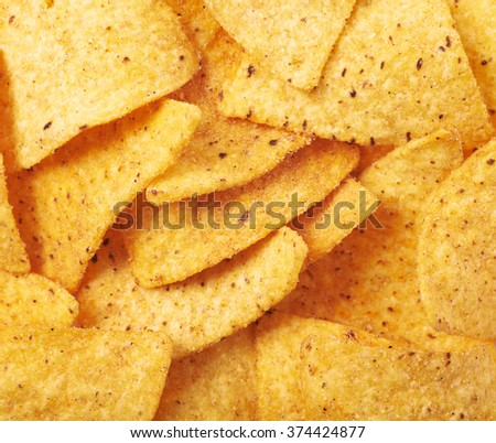 Surface covered with tortilla chips - stock photo