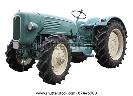 surface level view of a nostalgic blue tractor isolated on white - stock photo