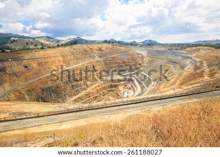 Surface mining of gold in an open pit mine in Waihi, New Zealand - stock photo