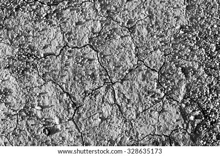 Surface of a grungy dry cracking parched earth for textural background. Black and white process - stock photo