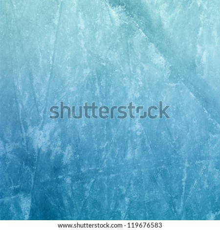 Surface of an Outdoor Ice Rink Replete with Skate Marks - stock photo
