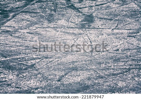 Surface of an Outdoor Ice Rink Replete with Skate Marks. - stock photo
