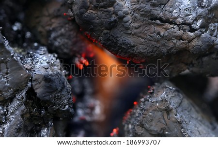 Surface of black bituminous coal with fire - stock photo