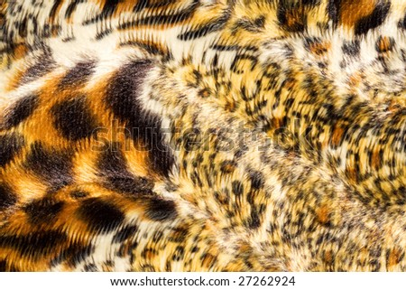Surface of spotted, fake fur. - stock photo