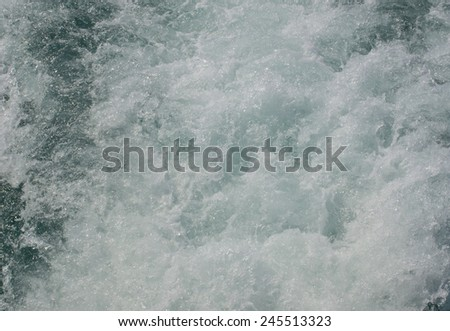 Surface of the water or the pressure of the air bubbles in the water - stock photo
