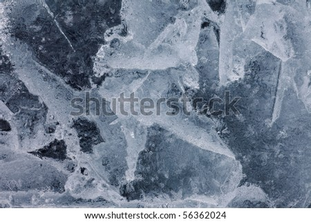 Surface of thick ice layer on lake, weathered by numerous thaw and freeze cycles. - stock photo