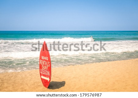 Surfboard at exclusive beach - Surfing school destinations worldwide - stock photo