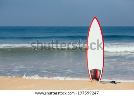Surfboard in the Sand - stock photo