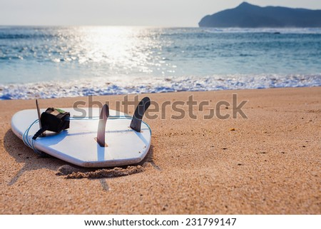 Surfboard on the wild beach of Sumbawa, Indonesia - stock photo