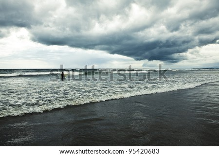 Surfer and ocean. Bali. Indonesia. - stock photo