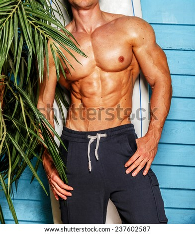 Surfer from Hawaii posing in the studio. - stock photo