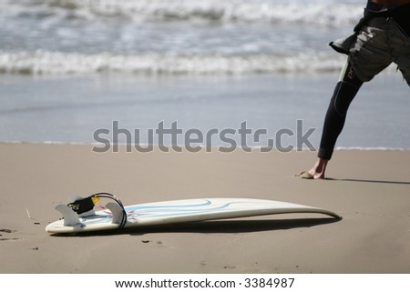 surfer getting ready to surf - stock photo