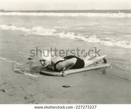 Surfer girl - stock photo