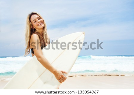 Surfer girl, bali - stock photo