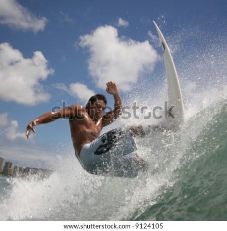 surfer hits the lip - stock photo
