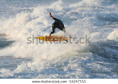 Surfer in the waves - stock photo
