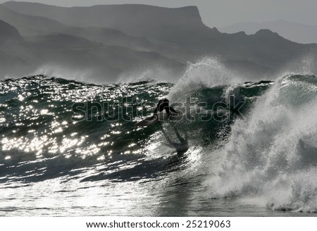 surfer making maneuver in the wave i Salsipuedes, Mexico - stock photo