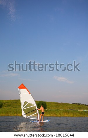 Surfer near the cost - stock photo