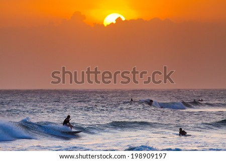 Surfer on Blue Ocean Wave in Bali, Indonesia - stock photo