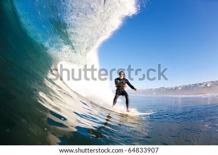 Surfer on Large Blue Wave - stock photo
