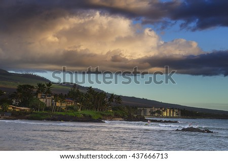 Surfer on Maui South shore at sunset - stock photo