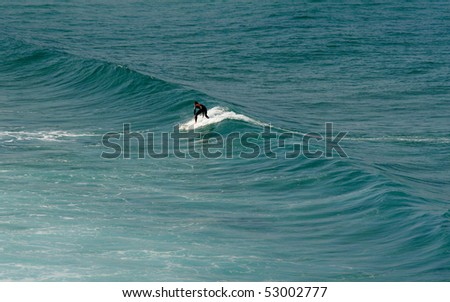 surfer on small wave - stock photo