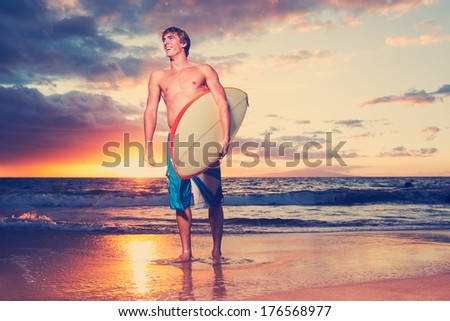 Surfer on the beach at sunset in Hawaii - stock photo