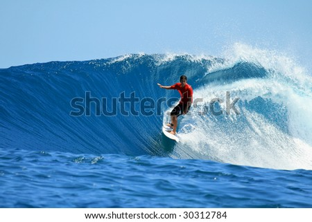 Surfer on tropical blue wave in red t-shirt, Mentawai Islands, Indonesia - stock photo