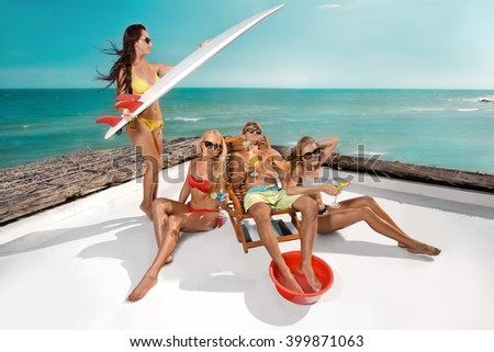 Surfer party stay on beach  - stock photo