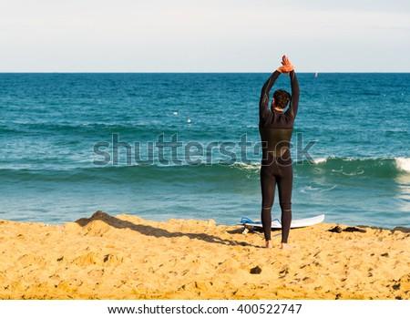surfer preparing on the beach  - stock photo
