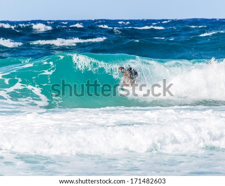 Surfer riding a wave on the North Shore of Oahu, Hawaii - stock photo