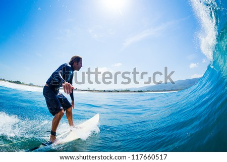 Surfer Riding Large Blue Ocean Wave - stock photo