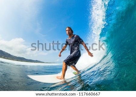 Surfer Riding Large Blue Ocean Wave - stock photo