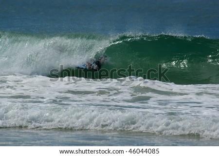 Surfer riding tube at mooloolaba sunshine coast australia - stock photo