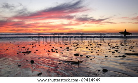 Surfer Silhouette at SUnset - stock photo
