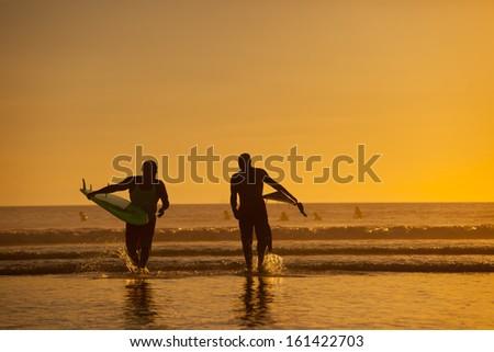 Surfers at Huntington Beach - stock photo