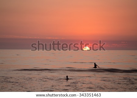 Surfers in La Jolla at Sunset - stock photo