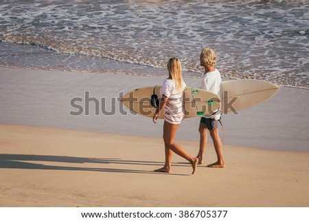 Surfers on the beach. Morning - stock photo