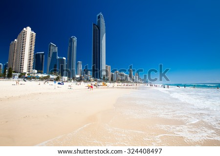 SURFERS PARADISE, AUS - OCT 03 2015 Skyline and a beach of Surfers Paradise, Gold Coast. It one of Australia's iconic coastal tourist destinations. - stock photo