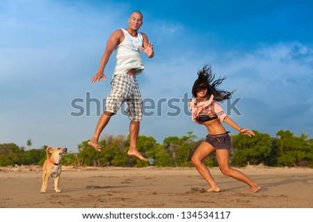 surfig couple posing on the beach - stock photo