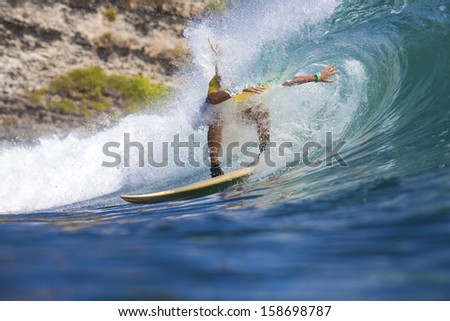 surfing a wave - stock photo