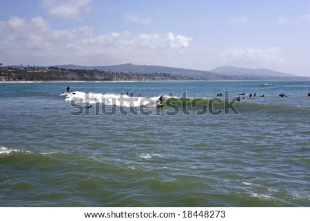 Surfing at Doheny State Beach looking South towards San Clemente - stock photo